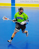 """Rochester Greywolves player with ball in a game against the Onondaga Redhawks in Can-Am Senior """"B"""" Box Lacrosse at the Onondaga Nation Arena near Nedrow, New York on Saturday, April 28, 2012."""