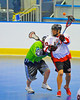 "Onondaga Redhawks Neal Powless (16) passes to a teammate against the Rochester Greywolves in Can-Am Senior ""B"" Box Lacrosse at the Onondaga Nation Arena near Nedrow, New York on Saturday, April 28, 2012."