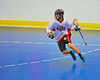 "Onondaga Redhawks Trevor Clark (2) carrying the ball against the Rochester Greywolves in Can-Am Senior ""B"" Box Lacrosse at the Onondaga Nation Arena near Nedrow, New York on Saturday, April 28, 2012."