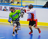"Onondaga Redhawks Dave Limbouris (5) stops a Rochester Greywolves player in Can-Am Senior ""B"" Box Lacrosse at the Onondaga Nation Arena near Nedrow, New York on Saturday, April 28, 2012."