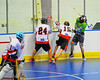 """Onondaga Redhawks Grant Bucktooth (15) and David Stout (24) pops the ball free from a Rochester Greywolves player in Can-Am Senior """"B"""" Box Lacrosse at the Onondaga Nation Arena near Nedrow, New York on Saturday, April 28, 2012."""