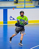 """Rochester Greywolves player passes to a teammate against the Onondaga Redhawks in Can-Am Senior """"B"""" Box Lacrosse at the Onondaga Nation Arena near Nedrow, New York on Saturday, April 28, 2012."""