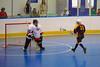 Tuscarora Tomahawk Dean Janzen (11) scores against Onondaga Redhawks goalie Ross Bucktooth (30) at the Onondaga Nation Arena near Nedrow, New York on Saturday, June 23, 2012.