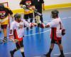Onondaga Redhawks A. J. Bucktooth (18) congratulates Dustin Hill (20) on his goal against the Tuscarora Tomahawks at the Onondaga Nation Arena near Nedrow, New York on Saturday, June 23, 2012.