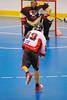 Onondaga Redhawks Dwayne Porter (23) lets a shot go against the Tuscarora Tomahawks at the Onondaga Nation Arena near Nedrow, New York on Saturday, June 23, 2012.
