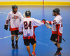Onondaga Redhawks David Stout (24) accepts congratulations from A. J. Bucktooth (18) and Dustin Hill (20) after scoring against the Tuscarora Tomahawks at the Onondaga Nation Arena near Nedrow, New York on Saturday, June 23, 2012.