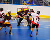Onondaga Redhawks A. J. Bucktooth (18) flips a shot voer the Tuscarora Tomahawks defender at the Onondaga Nation Arena near Nedrow, New York on Saturday, June 23, 2012.