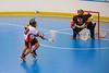 Onondaga Redhawks Brett Bucktooth (66) shoots and scores against the Tuscarora Tomahawks at the Onondaga Nation Arena near Nedrow, New York on Saturday, June 23, 2012.