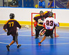 Onondaga Redhawks Dwayne Porter (23) bounces a shot past Tuscarora Tomahawks goalie Cory Henry (14) at the Onondaga Nation Arena near Nedrow, New York on Saturday, June 23, 2012.