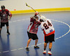 Onondaga Redhawks Dave Stout (24) fires in a goal past the Buffalo Creek Thunder defense at the Onondaga Nation Arena near Nedrow, New York on Sunday, May 5, 2013. Redhawks won 15-10.