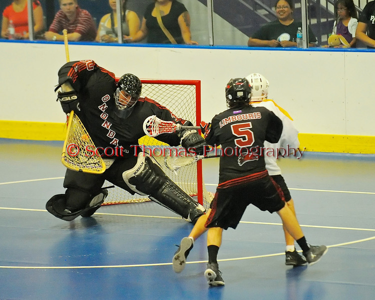 """Onondaga Redhawks Ross Bucktooth (30) makes a stop late in the game against the Tuscarora Tomahawks in Can-Am Senior """"B"""" playoff action at the Onondaga Nation Arena near Nedrow, New York.  Onondaga won 10-9."""