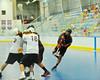 "Onondaga Redhawks Brett Bucktooth (66) shoots over players the Tuscarora Tomahawks net in Can-Am Senior ""B"" playoff action at the Onondaga Nation Arena near Nedrow, New York.  Onondaga won 10-9."