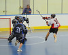 Onondaga Redhawks Pete Benedict (10)  shoots and scores on the Rochester Greywolves at the Onondaga Nation Arena near Nedrow, New York on Friday, April 26, 2013. Onondaga won 25-10.
