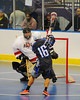 Onondaga Redhawks goalie Ross Bucktooth (1) keeping his eye on the ball in the stick of Rochester Greywolves James Schatt (16) at the Onondaga Nation Arena near Nedrow, New York on Friday, April 26, 2013. Onondaga won 25-10.