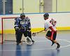 Onondaga Redhawks Haiwha Nonticole (22) scores on Rochester Greywolves goalie Mike Mattco (30) at the Onondaga Nation Arena near Nedrow, New York on Friday, April 26, 2013. Onondaga won 25-10.