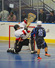Onondaga Redhawks goalie Ross Bucktooth (1) makes a save on a shot by Rochester Greywolves James Schatt (16) at the Onondaga Nation Arena near Nedrow, New York on Friday, April 26, 2013. Onondaga won 25-10.