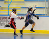 Onondaga Redhawks Wade Bucktooth (19) strips the ball away from Rochester Greywolves Nick Fischer (41) at the Onondaga Nation Arena near Nedrow, New York on Friday, April 26, 2013. Onondaga won 25-10.