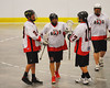 Onondaga Redhawks Neal Powless (16) is congratulated on his goal against the Allegany Arrows by Dwayne Porter (23) and Orris Edwards (17) at the Onondaga Nation Arena near Nedrow, New York on Saturday, May 3, 2014.  Onondaga won 21-5.