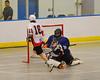 Allegany Arrows goalie Jake George (30) makes a save on Onondaga Redhawks Corey Thompson's (18) shot at the Onondaga Nation Arena near Nedrow, New York on Saturday, May 3, 2014.  Onondaga won 21-5.