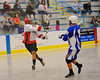 Onondaga Redhawks Wewoka Shenandoah (32) passing the ball against the Allegany Arrows at the Onondaga Nation Arena near Nedrow, New York on Saturday, May 3, 2014.  Onondaga won 21-5.