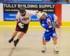 Onondaga Redhawks Brian Phillips Jr. (44) clotheslines Allegany Arrows Joe Dowdy (16) at the Onondaga Nation Arena near Nedrow, New York on Saturday, May 3, 2014.  Onondaga won 21-5.