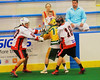 """Onondaga Redhawks Hiana Thompson (20) and Matt Noble (18) separate the ball from Newtown Golden Eagles Tyler Strassburg (77) in the Can-Am Senior """"B"""" Box Lacrosse finals at the Onondaga Nation Arena near Nedrow, New York on Saturday, August 2, 2014.  Onondaga won 11-5."""