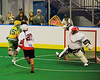 """Onondaga Redhawks goalie Edmund Cathers (0) makes a stick save on a shot by Newtown Golden Eagles Kyle Henry (75) in the Can-Am Senior """"B"""" Box Lacrosse finals at the Onondaga Nation Arena near Nedrow, New York on Saturday, August 2, 2014.  Onondaga won 11-5."""