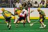 """Onondaga Redhawks Orris Edwards (14) drives past Newtown Golden Eagles defenders to score in the Can-Am Senior """"B"""" Box Lacrosse finals at the Onondaga Nation Arena near Nedrow, New York on Saturday, August 2, 2014.  Onondaga won 11-5."""