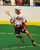 """Onondaga Redhawks Lyle Thompson (44) looking the make a play against the Newtown Golden Eagles in the Can-Am Senior """"B"""" Box Lacrosse finals at the Onondaga Nation Arena near Nedrow, New York on Saturday, August 2, 2014.  Onondaga won 11-5."""