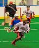 Onondaga Redhawks Tyler Hill (14) comes away with a loose ball against the Six Nations Slash at the Onondaga Nation Arena near Nedrow, New York on Sunday, June 29, 2014.  Onondaga won 30-6.
