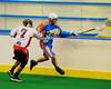 Onondaga Redhawks Mike Abrams (7) stick checks Six Nations Slash Brendon Morrison (8) at the Onondaga Nation Arena near Nedrow, New York on Sunday, June 29, 2014.  Onondaga won 30-6.