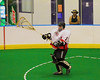 Onondaga Redhawks goalie Ross Bucktooth (1) making a clearing pass against the Six Nations Slash at the Onondaga Nation Arena near Nedrow, New York on Sunday, June 29, 2014.  Onondaga won 30-6.
