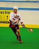 Onondaga Redhawks Haina Thompson (22) looking to make a play against the Six Nations Slash at the Onondaga Nation Arena near Nedrow, New York on Sunday, June 29, 2014.  Onondaga won 30-6.