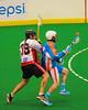 Onondaga Redhawks Bill O'Brien (35) knocks the ball loose from Six Nations Slash Jamie Speck (27) at the Onondaga Nation Arena near Nedrow, New York on Sunday, June 29, 2014.  Onondaga won 30-6.