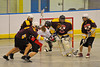 Onondaga Redhawks Cam Simpson (5) gets a shot off against the Tuscaroa Tomahawks at the Onondaga Nation Arena near Nedrow, New York on Saturday, April 26, 2014. Onondaga won 8-7 in overtime.