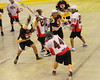 Onondaga Redhawks Brian Phillips Jr. (44) fires a shot over the Tuscaroa Tomahawks defenders at the Onondaga Nation Arena near Nedrow, New York on Saturday, April 26, 2014. Onondaga won 8-7 in overtime.