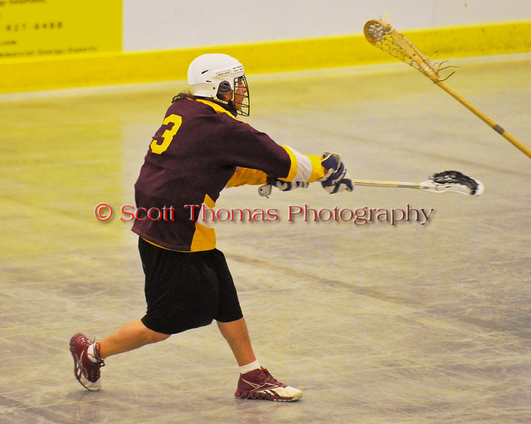 Tuscaroa Tomahawks Elisha Printup (3) fires a shot at the Onondaga Redhawks net at the Onondaga Nation Arena near Nedrow, New York on Saturday, April 26, 2014. Onondaga won 8-7 in overtime.