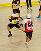 Onondaga Redhawks Lee Nanticoke (28) shots over the Tuscaroa Tomahawks defender at the Onondaga Nation Arena near Nedrow, New York on Saturday, April 26, 2014. Onondaga won 8-7 in overtime.