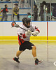 Onondaga Redhawks Brian Phillips Jr. (44) drives to the net against the Tuscaroa Tomahawks at the Onondaga Nation Arena near Nedrow, New York on Saturday, April 26, 2014. Onondaga won 8-7 in overtime.