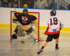 Onondaga Redhawks Wade Bucktooth (19) shot is stopped by Tuscaroa Tomahawks goalie Findley Wilson (31) at the Onondaga Nation Arena near Nedrow, New York on Saturday, April 26, 2014. Onondaga won 8-7 in overtime.