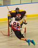 Onondaga Redhawks Trevor Clark's (26) shot is stopped by Tuscaroa Tomahawks goalie Findley Wilson (31) at the Onondaga Nation Arena near Nedrow, New York on Saturday, April 26, 2014. Onondaga won 8-7 in overtime.