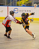 Onondaga Redhawks Buddy Bucktooth (13) defends a Tuscaroa Tomahawks player at the Onondaga Nation Arena near Nedrow, New York on Saturday, April 26, 2014. Onondaga won 8-7 in overtime.
