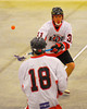 Onondaga Redhawks Derek Bennett (31) flips the ball to Troy Benedict (18) against the Tuscaroa Tomahawks at the Onondaga Nation Arena near Nedrow, New York on Saturday, April 26, 2014. Onondaga won 8-7 in overtime.