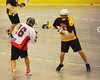 Onondaga Redhawks Neal Powless (16) fires a shot over the Tuscaroa Tomahawks defender at the Onondaga Nation Arena near Nedrow, New York on Saturday, April 26, 2014. Onondaga won 8-7 in overtime.