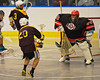 Onondaga Redhawks goalie Edmund Cathers (30) makes a save on Tuscaroa Tomahawks George Pineda (20) at the Onondaga Nation Arena near Nedrow, New York on Saturday, April 26, 2014. Onondaga won 8-7 in overtime.