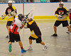 Onondaga Redhawks Trevor Clark (26) gets a shot over a Tuscaroa Tomahawks defender at the Onondaga Nation Arena near Nedrow, New York on Saturday, April 26, 2014. Onondaga won 8-7 in overtime.