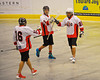 Onondaga Redhawks Neal Powless (16)  and Trevor Clark (26) congratulate Lee Nanticoke (28)  for his goal against the Tuscaroa Tomahawks at the Onondaga Nation Arena near Nedrow, New York on Saturday, April 26, 2014. Onondaga won 8-7 in overtime.