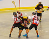 Onondaga Redhawks Grant Bucktooth (15)  and Trevor Clark (26) team up to check the Tuscaroa Tomahawks player at the Onondaga Nation Arena near Nedrow, New York on Saturday, April 26, 2014. Onondaga won 8-7 in overtime.