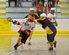Onondaga Redhawks Cam Simpson (5) gets high sticked by the Tuscaroa Tomahawks defender at the Onondaga Nation Arena near Nedrow, New York on Saturday, April 26, 2014. Onondaga won 8-7 in overtime.