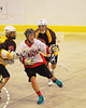 Onondaga Redhawks Trevor Clark (26) with the ball against the Tuscaroa Tomahawks at the Onondaga Nation Arena near Nedrow, New York on Saturday, April 26, 2014. Onondaga won 8-7 in overtime.